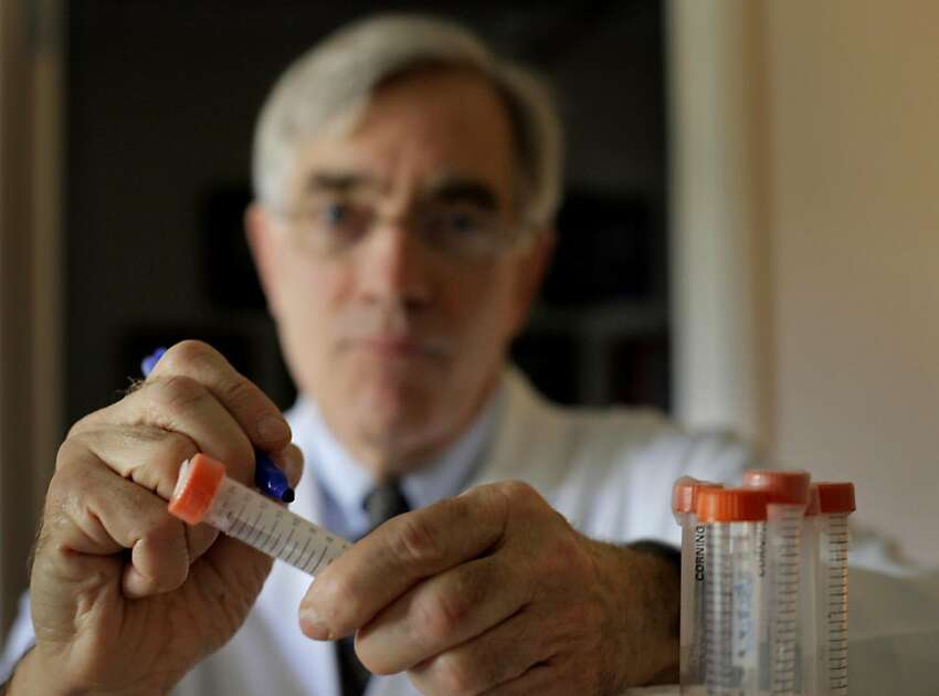 Dr. William Goodson III labels test tubes with a code, which is connected to the patient, and carries specimen, MOnday September 12, 2011, in San Francisco, Calif. Goodson is the lead author of a study that shows two chemicals common in consumer products -- bisphenol-A and methyl paraben -- cause healthy cells to grow and survive like cancer cells and can interfere with the effectiveness of anti-cancer drugs.