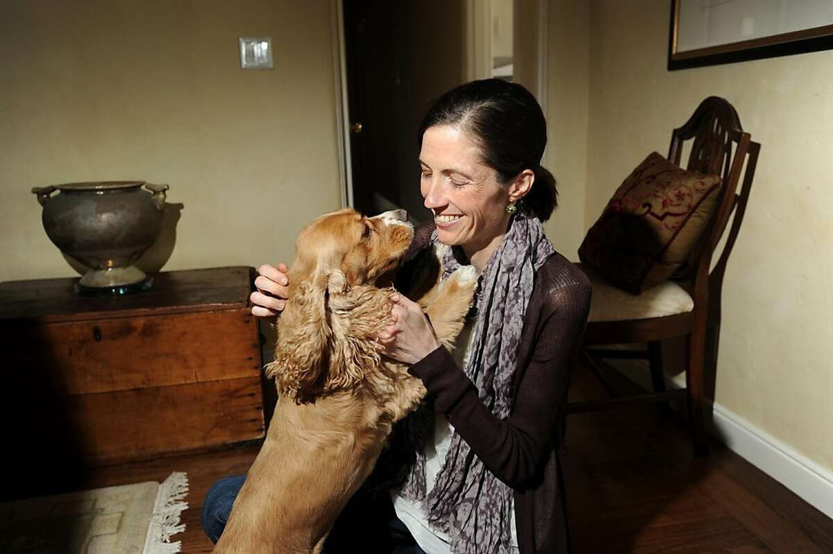Jeanene Harlick cuddles with her dog Franny at her mother's Burlingame, Calif., home on Thursday. Sept. 8, 2011. The 37-year-old San Mateo woman, who has battled severe anorexia for decades, sued Blue Shield of California for excluding residential treatment from covered expenses.