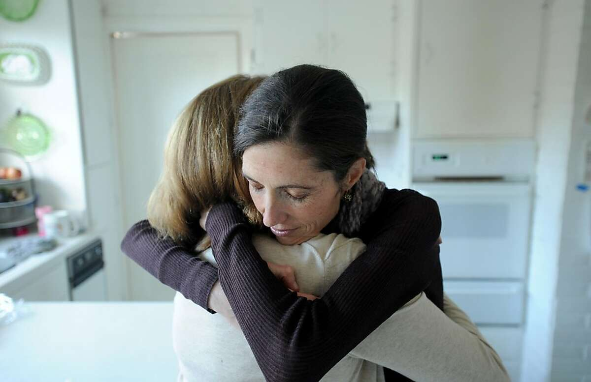 Jeanene Harlick hugs mom Robin Watson in Watson's Burlingame, Calif., home on Thursday. Sept. 8, 2011. The 37-year-old San Mateo woman, who has battled severe anorexia for decades, sued Blue Shield of California for excluding residential treatment from covered expenses.