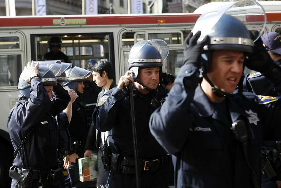 San Francisco Police officers don helmets before closing down the Powell Street BART and MUNI station following a protest involving free speech in the ticket area of the station on Thursday, September 8, 2011 in San Francisco, Calif. Photo: Beck Diefenbach, Special To The Chronicle