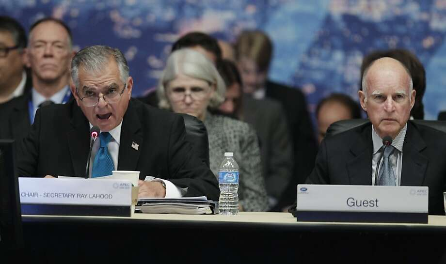 Calif. Gov. Jerry Brown, right, listens to Transportation Secretary Ray LaHood, left, at the APEC conference in San Francisco, Tuesday, Sept. 13, 2011.  (AP Photo/Paul Sakuma) Photo: Paul Sakuma, AP