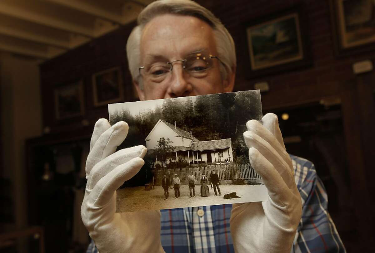 Howard May, volunteer and docent with the Trinity County Historical Society holds a late 1800's photograph of the Van Matre family home in Minersville, on Thursday September 8, 2011, in Weaverville, Ca. The home was lost when the town was flooded to create Trinity Lake back in 1961. Trinity Center, Stringtown, Minersville, Whiskeytown, Kennett - those and a dozen other once-booming towns are all buried underwater in Northern California reservoirs. But they are not forgotten. As the 50th anniversary of Shasta, Trinity and Whiskeytown reservoirs approaches, former residents still have very mixed, and mostly negative, feelings about the government burying their homes. Ran on: 09-12-2011 Historian Howard May holds a 19th century photo of the Van Matre family home in the lost town of Minersville.