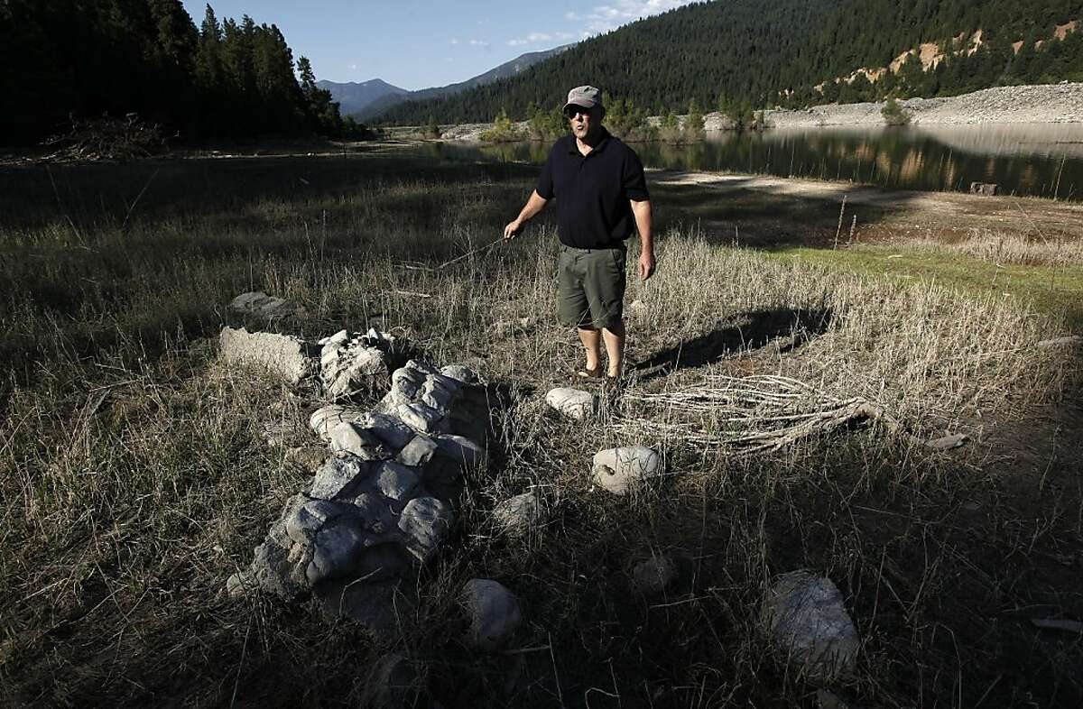 Keith Groves, who was the last baby to be born in the town of Stringtown, near the site of the town which is now covered by water at Trinity Lake on Thursday September 8, 2011, near Trinity Center, Ca. A remnant of a home, probably part of a porch, still remains along the shoreline. Trinity Center, Stringtown, Minersville, Whiskeytown, Kennett - those and a dozen other once-booming towns are all buried underwater in Northern California reservoirs. But they are not forgotten. As the 50th anniversary of Shasta, Trinity and Whiskeytown reservoirs approaches, former residents still have very mixed, and mostly negative, feelings about the government burying their homes.