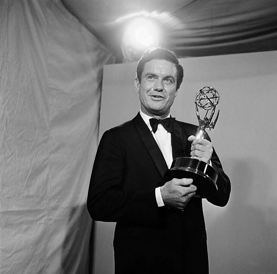 "FILE - In this May 22, 1966 file photo, actor Cliff Robertson holds the Emmy he won for the outstanding single performance by an actor in a leading role in a drama at the 18th annual Television Academy Awards in the Hollywood section of Los Angeles. Robertson, the movie actor who played John F. Kennedy in ""PT-109,"" won an Oscar for ""Charly"" and was famously victimized in a 1977 Hollywood forgery scandal, died Saturday, Sept. 10, 2011. He was 88. (AP Photo) Ran on: 09-11-2011 Cliff Robertson holds the Emmy he won for outstanding performance. Photo: AP"