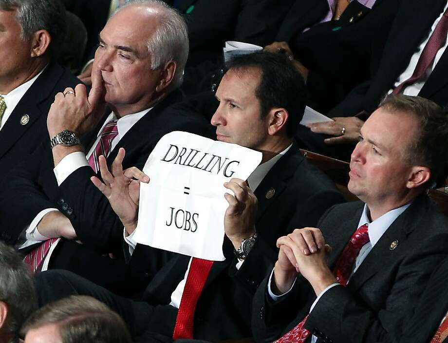 Rep. Jeff Landry, R-La., holds a sign during a speech by President Barack Obama to a joint session of Congress at the Capitol in Washington, Thursday, Sept. 8, 2011.  (AP Photo/Charles Dharapak) Photo: Charles Dharapak, AP