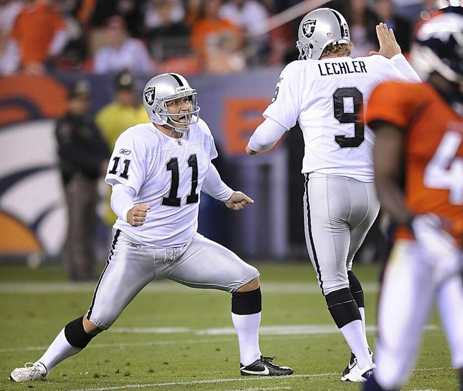Oakland Raiders kicker Sebastian Janikowski (11) reacts with Oakland Raiders punter Shane Lechler (9) after kicking a 63-yard field goal against the Denver Broncos in the second quarter of an NFL football game, Monday, Sept. 12, 2011, in Denver. (AP Photo/Jack Dempsey) Photo: Jack Dempsey, AP