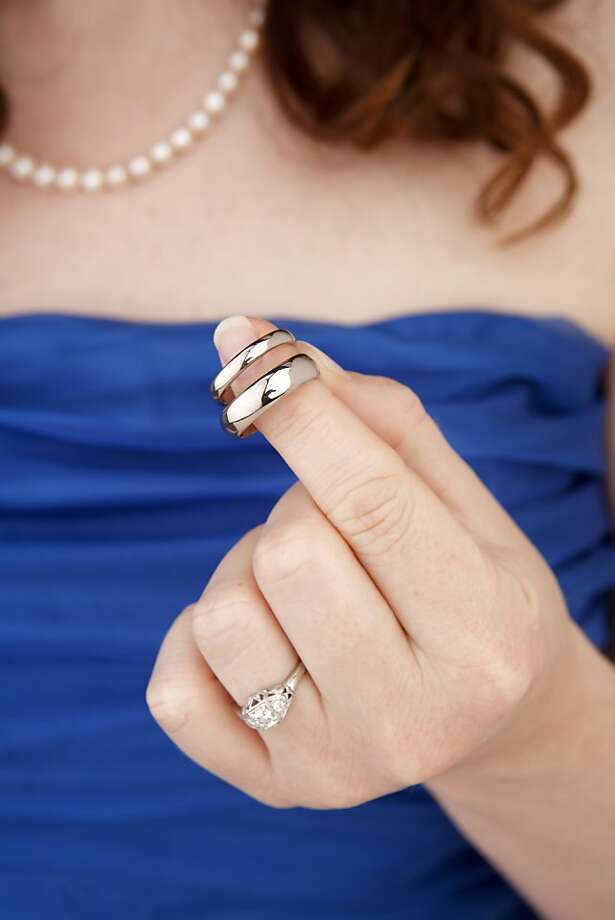 Sara Faith Alterman, seen on Friday, Sep. 2, 2011 in San Francisco, Calif., holds the wedding rings she and her fiancè, Sam Hawes, made. Photo: Russell Yip, The Chronicle