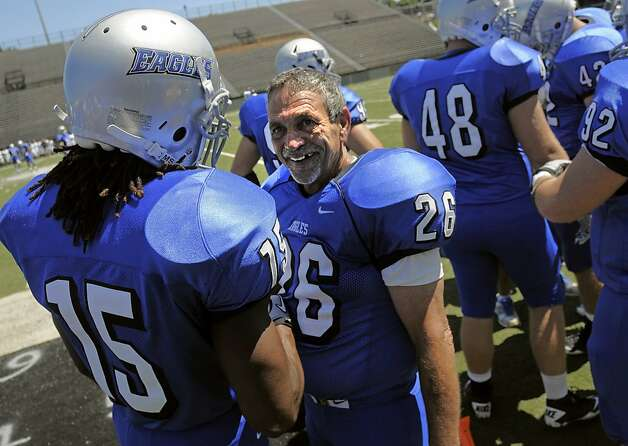 Faulkner's Alan Moore (26) is congratulated by teammate Don Lee, left, after kicking an extra point during an NAIA college football game against Ave Maria University at Cramton Bowl in Montgomery, Ala. Saturday, Sept. 10, 2011. Moore, 61, a Vietnam veteran and grandfather of five, became the oldest player ever to get in a college football game Saturday. (AP Photo, David Bundy) Photo: David Bundy, AP