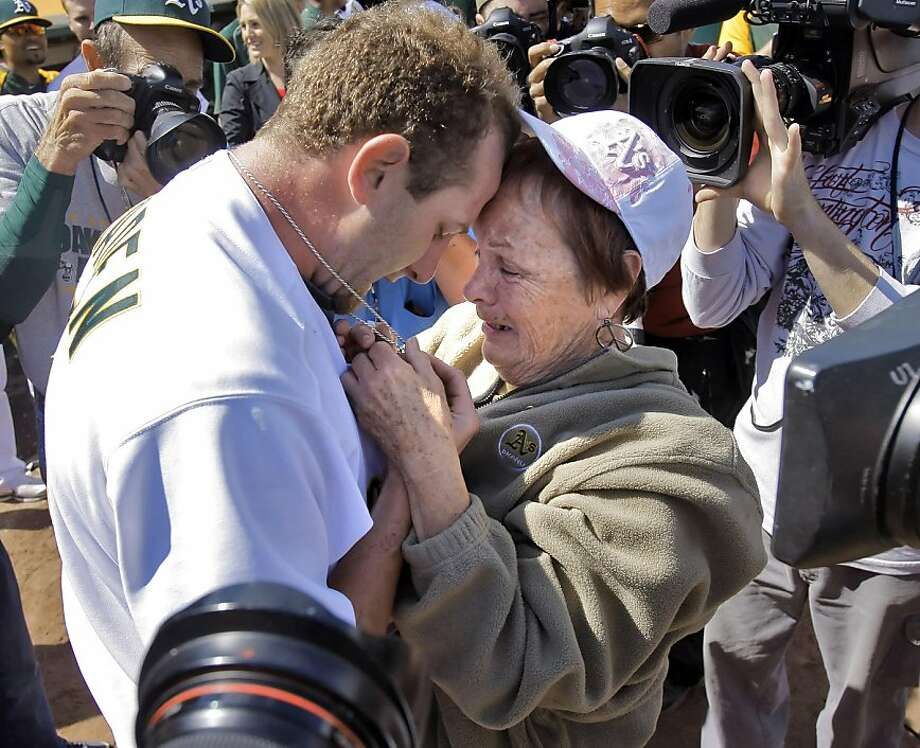 Dallas Braden celebrates with his grandmother, Peggy Lindsey of Stockton, Calif., after pitching a perfect game on Mother's Day. Braden's mother has passed away and his grandmother attended the game. The chain around Braden's neck is a memoir of his mother that used to hold her wedding ring until he lost it years ago. He has worn it for years and when it has broken, he's held it together with paper clips and safety pins according to Lindsey. The perfect game is the 19th in MLB history. The Oakland Athletics played the Tampa Bay Rays at the Oakland Alameda County Coliseum in Oakland, Calif., on Sunday, May 9, 2010.  Ran on: 05-10-2010 After his incredible feat Sunday, Dallas Braden embraces his grandmother, Peggy Lindsey, at the Oakland Coliseum. He could not hug his mother, who died of cancer when he was in high school. Ran on: 05-10-2010 After his incredible feat Sunday, Dallas Braden embraces his grandmother, Peggy Lindsey, at the Oakland Coliseum. She raised him after his mother died of cancer while he was in high school.   **MANDATORY CREDIT FOR PHOTOG AND SF CHRONICLE/NO SALES/MAGS OUT/TV OUT/INTERNET: AP MEMBER NEWSPAPERS ONLY** Photo: Carlos Avila Gonzalez, The Chronicle