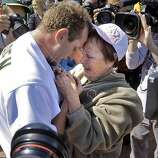 Dallas Braden celebrates with his grandmother, Peggy Lindsey of Stockton, Calif., after pitching a perfect game on Mother's Day. Braden's mother has passed away and his grandmother attended the game. The chain around Braden's neck is a memoir of his mother that used to hold her wedding ring until he lost it years ago. He has worn it for years and when it has broken, he's held it together with paper clips and safety pins according to Lindsey. The perfect game is the 19th in MLB history. The Oakland Athletics played the Tampa Bay Rays at the Oakland Alameda County Coliseum in Oakland, Calif., on Sunday, May 9, 2010.  Ran on: 05-10-2010 After his incredible feat Sunday, Dallas Braden embraces his grandmother, Peggy Lindsey, at the Oakland Coliseum. He could not hug his mother, who died of cancer when he was in high school. Ran on: 05-10-2010 After his incredible feat Sunday, Dallas Braden embraces his grandmother, Peggy Lindsey, at the Oakland Coliseum. She raised him after his mother died of cancer while he was in high school.   **MANDATORY CREDIT FOR PHOTOG AND SF CHRONICLE/NO SALES/MAGS OUT/TV OUT/INTERNET: AP MEMBER NEWSPAPERS ONLY**