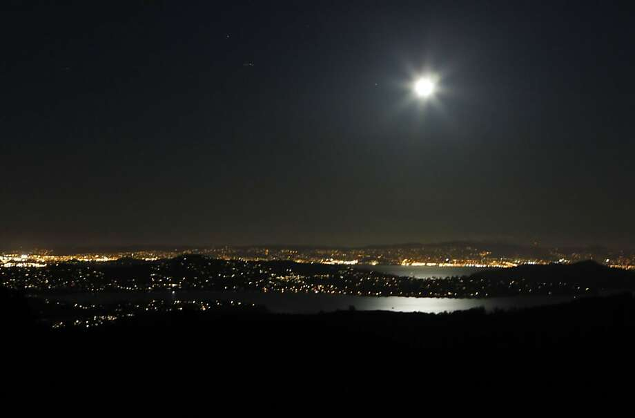 The nearly full moon reflects light off Richardson Bay from this view looking east from Muir Trail near Mt Tamalpais, Calif., on Monday, February 9, 2009.   Ran on: 09-01-2009 The nearly full moon reflects light off Richardson Bay from this view looking east from Muir Trail near Mount Tamalpais. Photo: Michael Maloney, The Chronicle