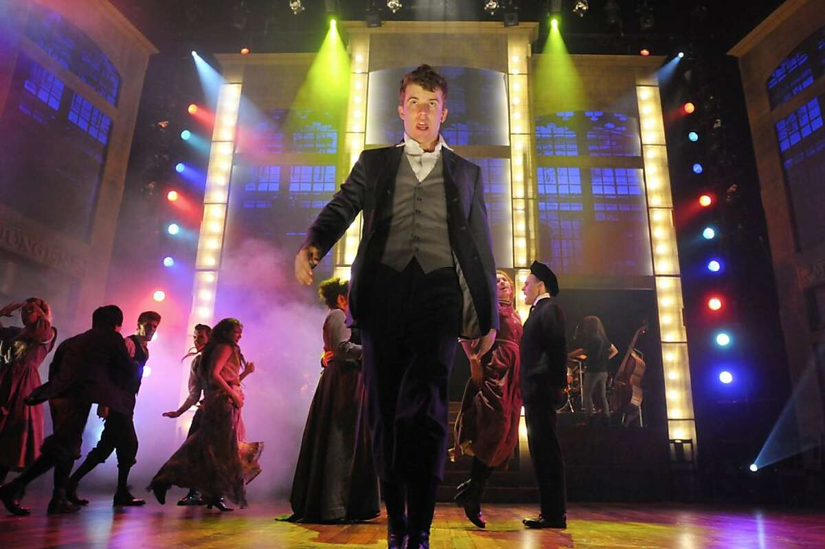 Melchior (Jason Hite, center) struts during a teen dance in San Jose Rep's production of the musical