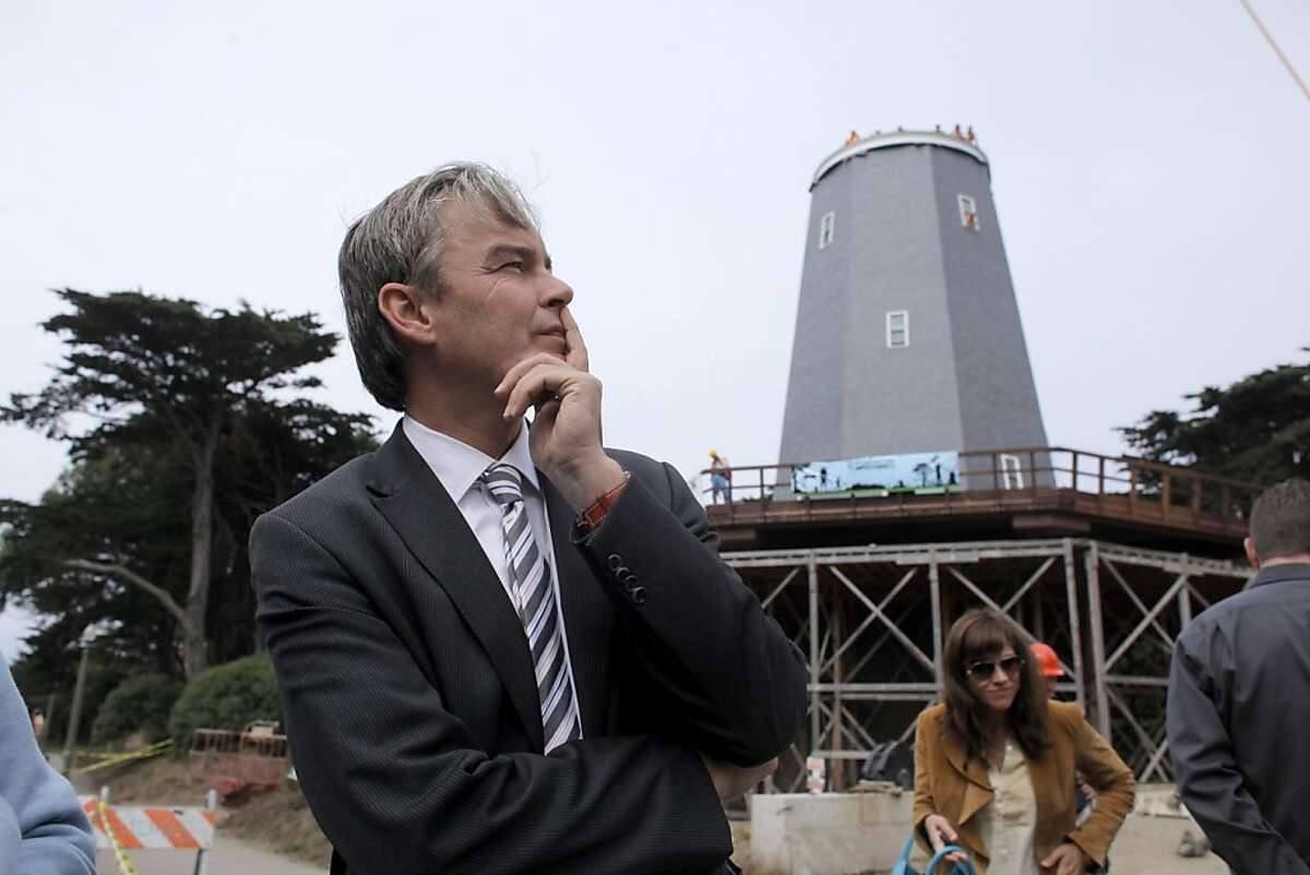 Consul General for the Netherlands in San Francisco, Bart van Bolhuis, listens to donors at the raising of the 64 ton copper windmill and placing it on top of the Samuel Murphy Windmill, Monday September 12, 2011 in Golden Gate Park in San Francisco, Calif.