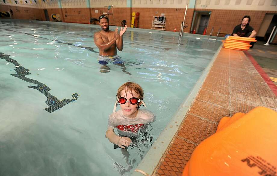 Noah Zaslavsky, 8, gets encouragement from instructor Daniel Hawkins-Collins during a class offered through the city's Recreation and Parks department on Wednesday, Sept. 7, 2011, at San Francisco's Garfield pool. Photo: Noah Berger, Special To The Chronicle