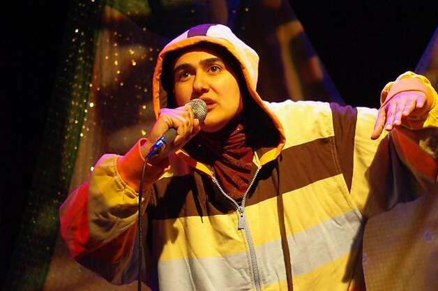 "Unveiled 5 - Rohina Malik plyas Shabana, a South Asian Rapper from London, one of five characters in her one-woman show ""Unveiled"" at the Brava Theater. Photo by Sadaf Syed. Photo: Sadaf Syed"