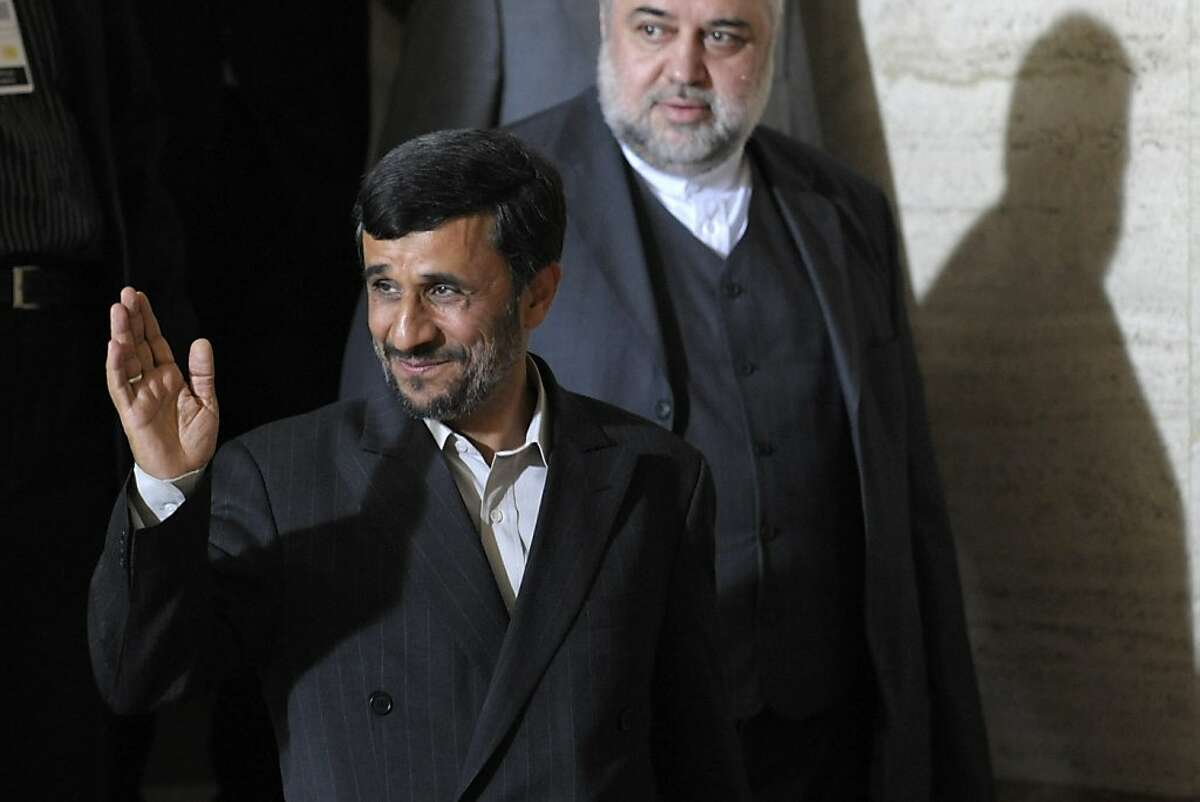 Iranian President Mahmoud Ahmadinejad, front, waves next to Ali Reza, head of Iran's mission to the United Nations, after a bilateral meeting with Ban Ki-moon, Secretary-General of the United Nations on the sideline of the Durban Review Conference (UN's Conference against Racism) at the European headquarters of the United Nations, UN, in Geneva, Switzerland, Monday, April 20, 2009. The Durban Review Conference, to be held in Geneva, Switzerland, 20-24 April 2009, will evaluate progress towards the goals set by the World Conference against Racism, Racial Discrimination, Xenophobia and Related Intolerance in Durban, South Africa, in 2001. (AP Photo/Keystone, Laurent Gillieron) Ran on: 04-22-2009 President Mahmoud Ahmadinejad is backed by powerful hard-liners, but his popularity is waning among some who say he spends too much time slamming the United States and Israel.