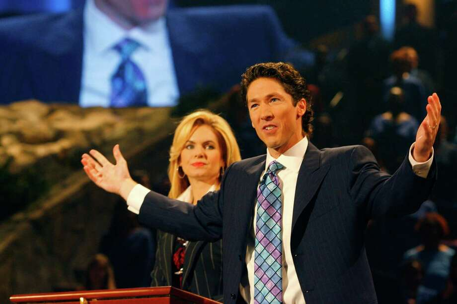 Joel and Victoria (his wife) Osteen lead a worship service, Sunday, at Lakewood Church, the congregation he took over 8 years ago after the death of his father, John Osteen,  founder of the institution. Osteen moved the congregation from its outgrown northeast Houston established site to the building formerly known as the Compaq Center and before that as the Summit. Dodie Osteen, John's widow and Joel's mother, sat near him during parts of the service. Sunday, Sept. 30, 2007, in Houston. (Steve Ueckert / Chronicle) Photo: Steve Ueckert, Staff / Houston Chronicle