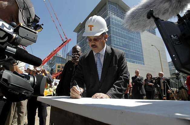 San Francisco Mayor Ed Lee signs his name to a steel beam being used in the project as he joined officials as they kick off the construction phase of the Transbay Transit Center on Wednesday September 7, 2011, in downtown San Francisco, Ca. Photo: Michael Macor, The Chronicle