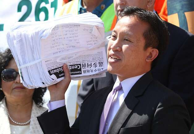 Board of Supervisors president David Chiu holds up a bundle of petitions at a rally in support of the Central Subway project at City Hall on Friday, Sept. 9, 2011. Photo: Mathew Sumner, Special To The Chronicle