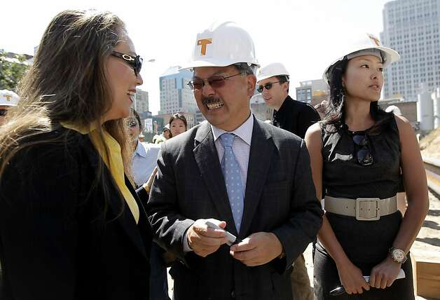 San Francisco Mayor Ed Lee spekas with the Executive Director of the Transbay Joint Powers Authority, Maria Ayerdi-Kaplan, as they kick off the construction phase of the Transbay Transit Center on Wednesday September 7, 2011, in downtown San Francisco, Ca.  San Francisco supervisor Jane Kim at right. Photo: Michael Macor, The Chronicle