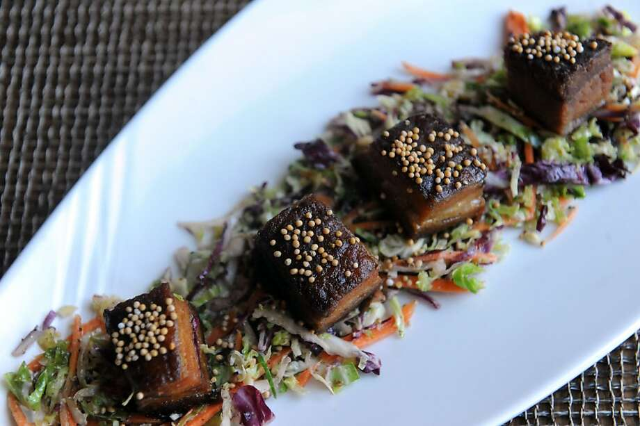 Soy glazed pork belly with gingered brussel sprouts slaw  is a specialty at the Bank Bar and Cafe in Napa. Photo: Susana Bates, Special To The Chronicle