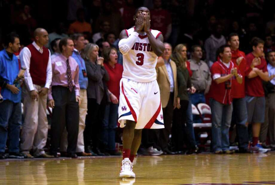 Houston guard J.J. Thompson reacts to the Cougars being called for a foul with 1.7 second left against LSU during the second half of an NCAA college basketball game at Hofheinz Pavilion Tuesday, Nov. 29, 2011, in Houston. LSU hit the two ensuing free throws to beat Houston 59-58. Photo: Brett Coomer, Houston Chronicle / © 2011 Houston Chronicle