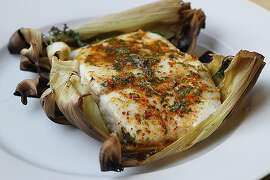 Halibut grilled on corn husks.