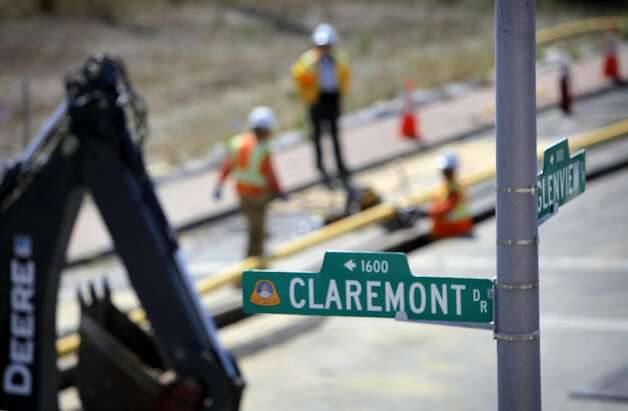 PG&E workers dig up the intersection of Glenview and Claremont to place the distribution gas lines, Wednesday August 31, 2011, to the homes that were destroyed in the pipeline explosion in San Bruno, Calif. last September. Photo: Lacy Atkins, The Chronicle
