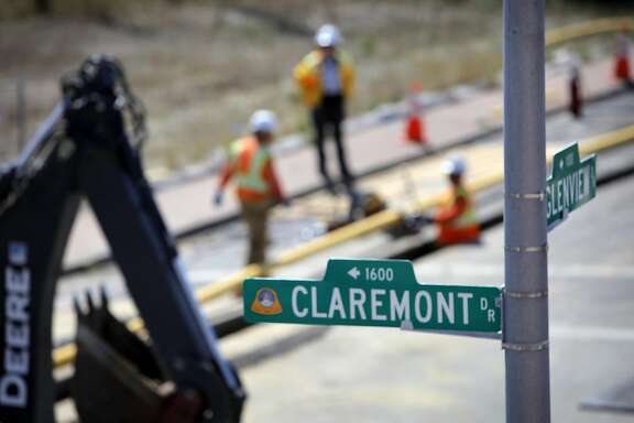 PG&E workers dig up the intersection of Glenview and Claremont to place the distribution gas lines, Wednesday August 31, 2011, to the homes that were destroyed in the pipeline explosion in San Bruno, Calif. last September.