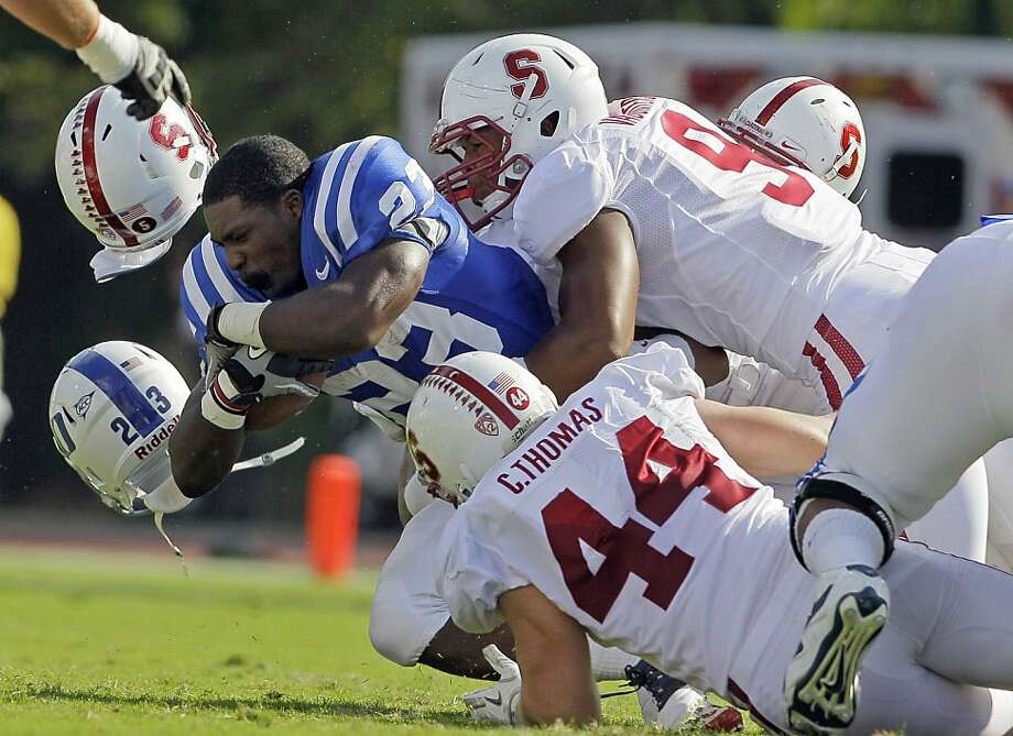 Stanford's Chase Thomas (44) and James Vaughters tackle Duke's Juwan Thompson (23) during the first half of an NCAA college football game in Durham, N.C., Saturday, Sept. 10, 2011. (AP Photo/Gerry Broome) Photo: Gerry Broome, AP