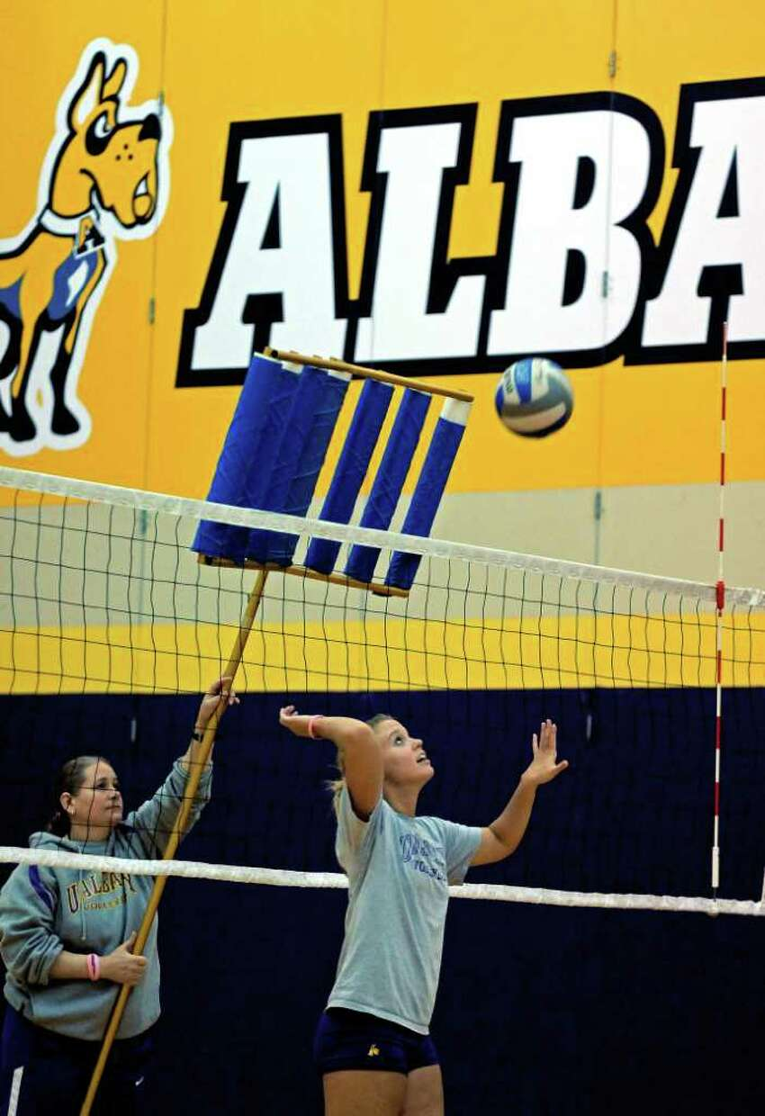 UAlbany women's volleyball coach MJ Engstrom, left, leads practice as setter Brooke Stanley and her teammates prepare to play in the NCAA tournament, on Monday Nov. 28, 2011 in Albany, NY. (Philip Kamrass / Times Union )