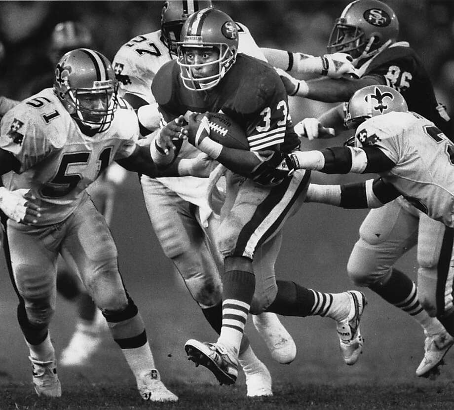 CRAIG-11DEC1988-LARSON - 49'er Roger Craig runs through the New Orleans defense, on Dec. 11, 1988, at Candlestick Park, San Francisco.  49'ers win over New Orleans, 30-17.  photo by Fred Larson  Ran on: 09-07-2011 Roger Craig is second on the 49ers' career list  --  at least for now. Photo: Frederic Larson, The Chronicle