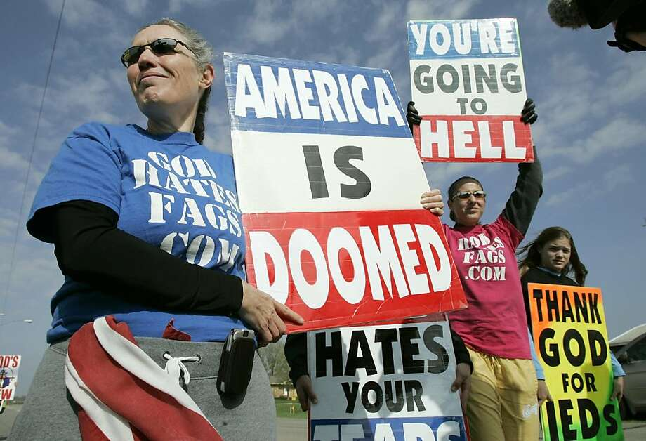 ** ADVANCE FOR SUNDAY, JUNE 4 **Shirley Phelps-Roper, left, a member of the Westboro Baptist Church, of Topeka, Kan., holds a protest sign outside funeral services for Sgt. Daniel Sesker, Tuesday, April 18, 2006, Ogden, Iowa. (AP Photo/Charlie Neibergall) Ran on: 06-11-2006 Pastor Fred Phelps, a former civil rights attorney and political candidate, preaches at his Westboro Baptist Church in Topeka, Kan. Photo: Charlie Neibergall, AP