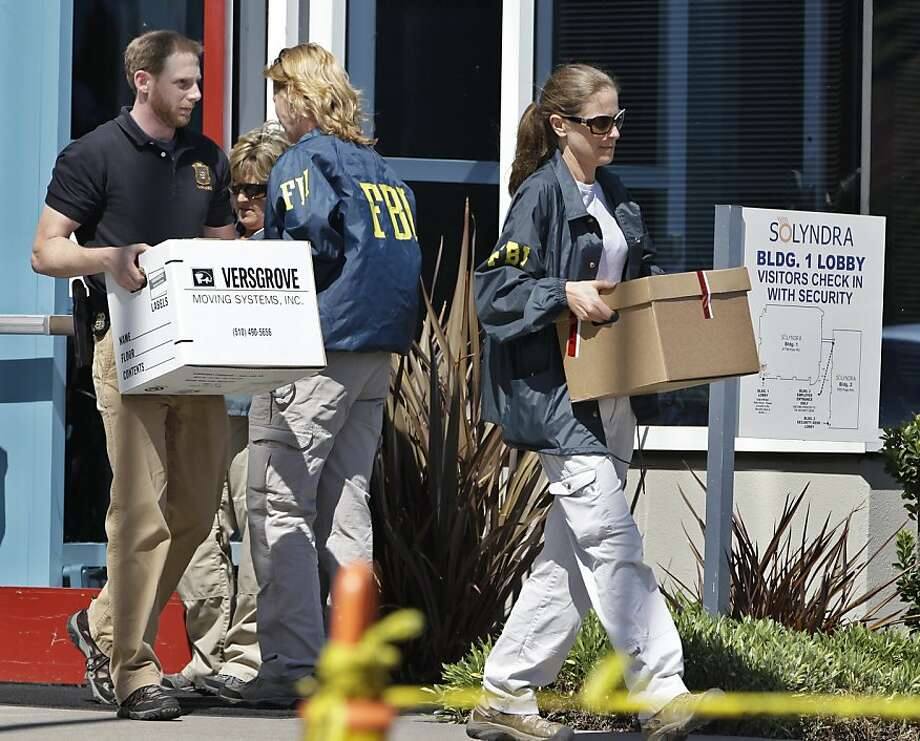 FBI agent carry dozens of boxes of evidence from Solyndra headquarters in Fremont, Calif., Thursday, Sept. 8, 2011. The FBI are executing search warrants at the headquarters of California solar firm Solyndra that received a $535 million loan from the federal government. (AP Photo/Paul Sakuma) Photo: Paul Sakuma, AP