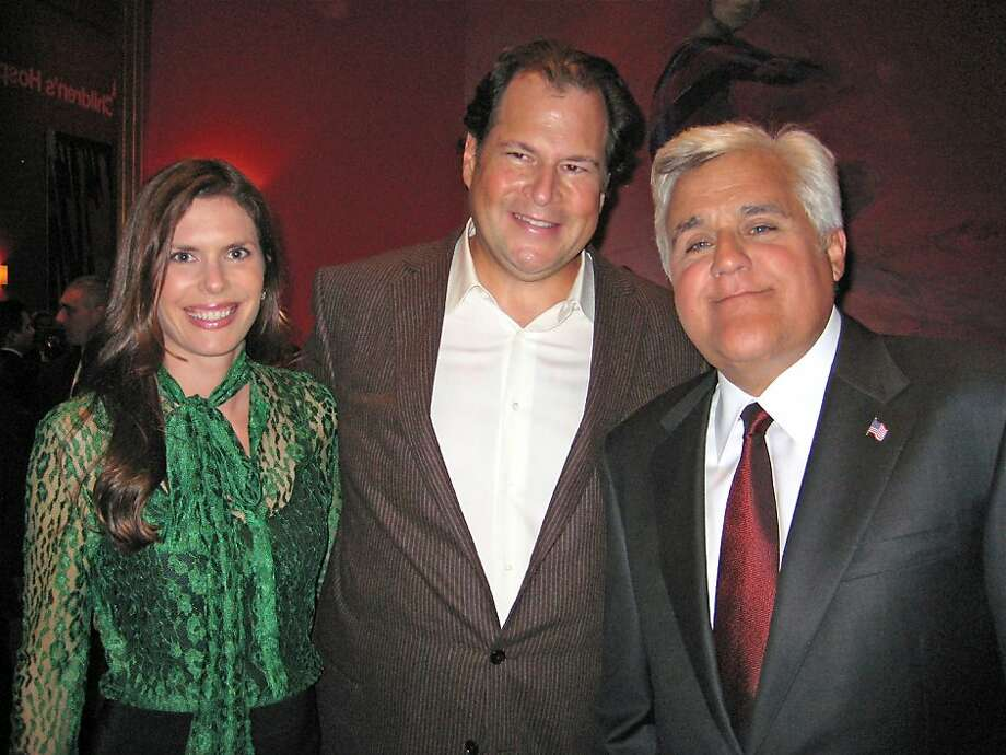 Lynne and Marc Benioff (left) with comedian Jay Leno at Davies Symphony Hall where the Benioff's hosted a concert in support of UCSF's new Benioff Children's Hopsital. Sept 2011. By Catherine Bigelow. Photo: Catherine Bigelow, Special To The Chronicle