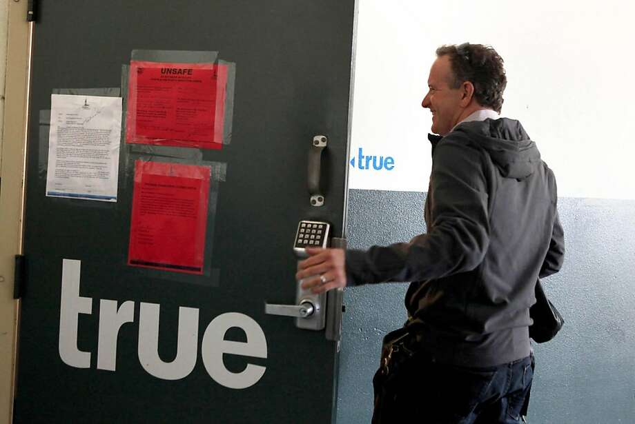 Jon Callaghan, one of the founders of True Ventures, the first tech company tenant at pier 38 enters his office through a red-tagged door at Pier 38 in San Francisco, CA on Thursday September 8, 201.  San Francisco Port has stated that the tenants must vacate by September 30th. photo by Kat Wade / Special to The San Francisco Chronicle Photo: Kat Wade, Special To The Chronicle