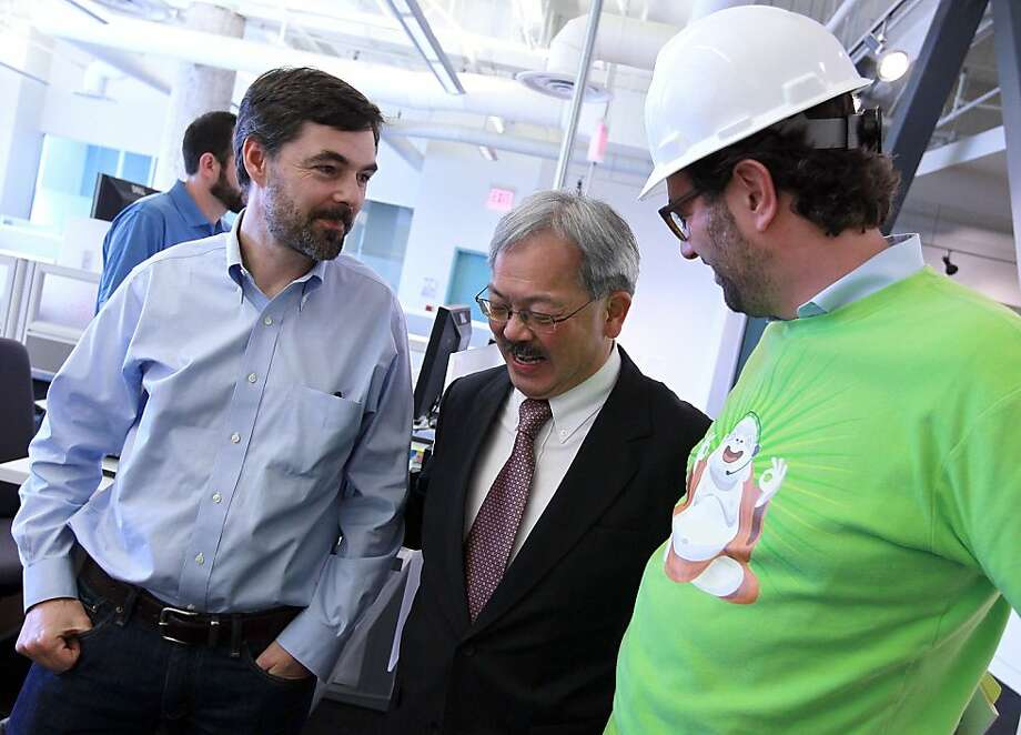 SAN FRANCISCO, CA - AUGUST 30:  San Francisco mayor Ed Lee (C) greets workers as he tours the Zendesk office with Zendesk CEO Mikkel Svane (R) on August 30, 2011 in San Francisco, California.  San Francisco mayor Ed Lee officially opened the offices of Zendesk, a provider of cloud-based help desk software, is the first business to open on San Francisco's Central Market district since the adoption of the Central Market and Tenderloin Area payroll tax exclusion.  (Photo by Justin Sullivan/Getty Images) Photo: Justin Sullivan, Getty Images