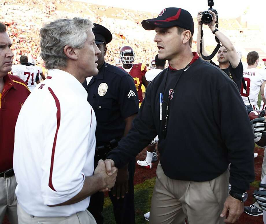 Southern California head coach Pete Carroll, left, and Stanford head coach Jim Harbaugh greet each other after a NCAA college football game in Los Angeles on Saturday, Nov. 14, 2009. Stanford won 55-21. (AP Photo/Matt Sayles)  Ran on: 09-08-2011 Sunday's foes, Pete Carroll (left) and Jim Harbaugh, had a testy meeting as college coaches two years ago. Photo: Matt Sayles, ASSOCIATED PRESS