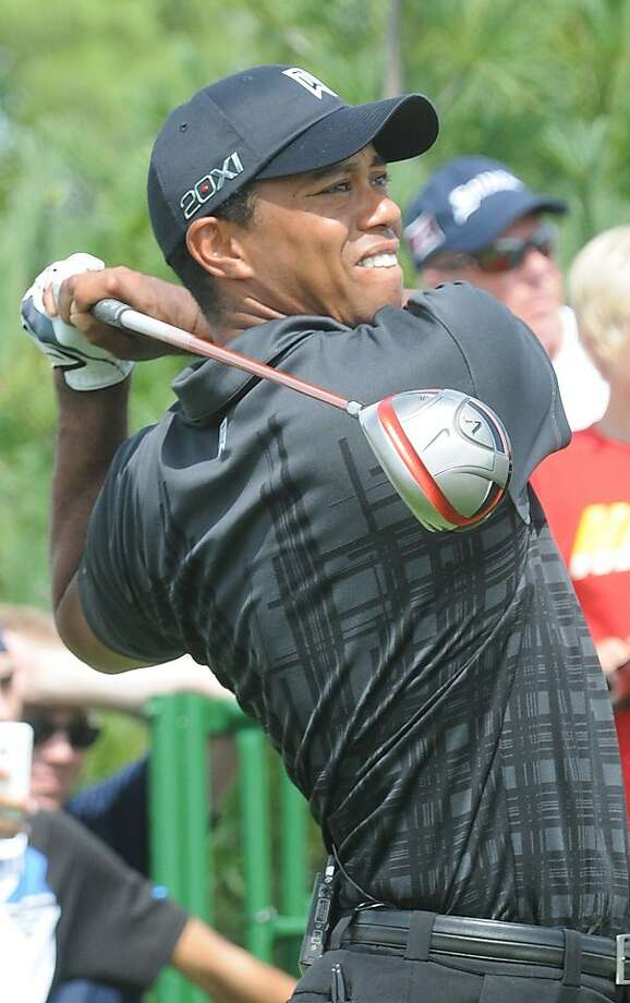 Tiger Woods hits a tee shot during the Notah Begay III Foundation Challenge golf tournament in Verona, N.Y., Wednesday, Aug. 31, 2011. (AP Photo/The Syracuse Newspapers, Stephen D. Cannerelli) MAGS OUT, TV OUT, NO ARCHIVE Photo: Stephen D. Cannerelli, AP