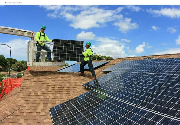 SolarCity workers install solar panels on rooftops at Hickam Communities at Joint Base Pearl Harbor-Hickam, where developer Lend Lease and SolarCity have partnered on the first SolarStrong-eligible project (Photo: Business Wire)  Ran on: 09-08-2011 SolarCity workers install solar panels on rooftops at Hickam Communities at Joint Base Pearl Harbor-Hickam in Hawaii, where the first work of the huge project has begun.   Ran on: 11-30-2011 SolarCity workers install solar panels on the roofs of military housing units at Hawaii's Joint Base Pearl Harbor- Hickam, part of a five-year, $1 billion program. Photo: Lend Lease, Business Wire