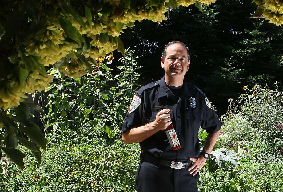 Fireman Lee Taylor at the garden behind fire station #5 in Palo Alto, Ca., on Wednesday, August 31, 2011.  When he harvested an overgrowth of peppers in the Palo Alto firehouse garden, he created his personal blend of hot sauce.  Palo Alto Firefighters Pepper Sauce is shipped around the country, and is a non-profit that using proceeds from it's sales, handing out 47 college scholarships to local teens, among other charities. Photo: Liz Hafalia, The Chronicle