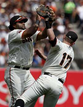Pablo Sandoval (left) and Aubrey Huff (right) collide catching a popup from Chris Young in the first inning.  Huff made the catch. The San Francisco Giants in action against the Arizona Diamondbacks Sunday September 4, 2011 at AT&T Park.