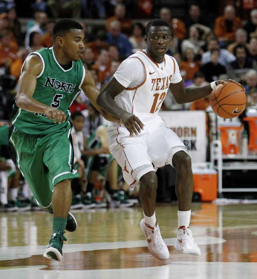 Texas' Myck Kabongo (12) is defended by North Texas' Chris Jones (5) during the second half of an NCAA college basketball game, Tuesday, Nov. 29, 2011, in Austin, Texas. (AP Photo/Eric Gay) Photo: Eric Gay, Associated Press / AP