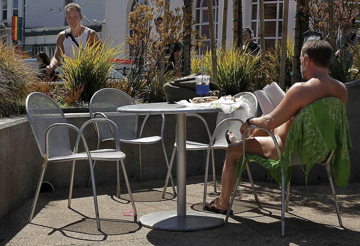 Eric Anderson, enjoys the weather while in the nude at a parklet at the corner of 17th street and Castro in San Francisco, Ca. , on Tuesday September 6, 2011. Since it really hasn't been a crime to walk around nude in the city, at the very least these naked folks could put a cover on chairs when they dine and put a few clothes on too, at least that's what Supervisor Scott Wiener is proposing with new legislation that he will introduce at the Board of Supervisors today.