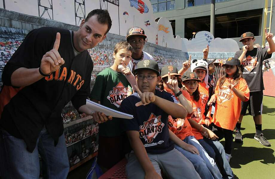 "San Francisco Giants pitcher Ryan Vogelsong and players on his Junior Giants Financial Baseball team send in a signal to the ""batter"" at the plate on the Fan Lot mini-diamond at AT&T Park in San Francisco, Calif. on Saturday, Sept. 3, 2011. Photo: Paul Chinn, The Chronicle"