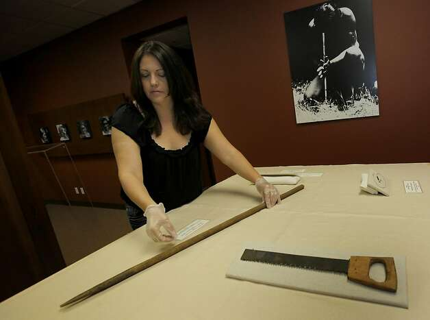 "California Indian Museum director Nicole Lim handles a spear made by Ishi to hunt salmon. An exhibition on Ishi, much of it from the Phoebe A. Hearst Museum of Anthropology, is at the California Indian Museum in Santa Rosa, Calif. A century after a Native American known as Ishi emerged from the Northern California wilderness to be labeled ""the last wild Indian"" and become a celebrity in San Francisco, Calif., a conference about his legacy will be held at UC Berkeley. Photo: Brant Ward, The Chronicle"