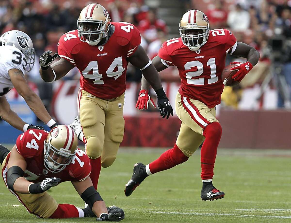 San Francisco 49ers running back Frank Gore (21) gets outside on a first quarter run, blocking from teammate fullback Moran Norris (44), as the San Francisco 49ers take on the Oakland Raiders in preseason action at Candlestick Park in San Francisco, Calif. on Saturday August 20, 2011. Ran on: 08-22-2011 Frank Gore is frustrated with the 49ers, according to some media outlets. Ran on: 08-22-2011 Frank Gore is frustrated with the 49ers, according to some media outlets.
