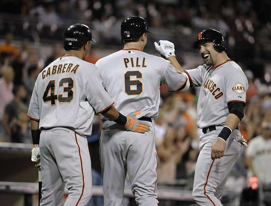 SAN DIEGO, CA - SEPTEMBER 6:  Brett Pill #6 of the San Francisco Giants is congratulated by Orlando Cabrera #43 and Mark DeRosa #7 after hitting a two-run homer during the second inning of a baseball game against the San Diego Padres at Petco Park on September 6, 2011 in San Diego, California.  (Photo by Denis Poroy/Getty Images) Photo: Denis Poroy, Getty Images