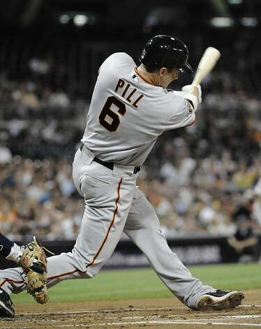 SAN DIEGO, CA - SEPTEMBER 6:  Brett Pill #6 of the San Francisco Giants hits a two-run homer during the second inning of a baseball game against the San Diego Padres at Petco Park on September 6, 2011 in San Diego, California.  (Photo by Denis Poroy/Getty Images) Photo: Denis Poroy, Getty Images