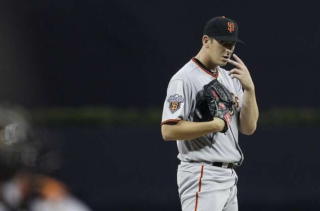 San Francisco Giants starting pitcher Eric Surkamp motions to catcher Chris Stewart while playing San Diego Padres in the first inning during their baseball game Tuesday, Sept. 6, 2011, in San Diego. (AP Photo/Gregory Bull) Photo: Gregory Bull, AP